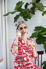 Portrait of stylish senior woman on mobile phone at home