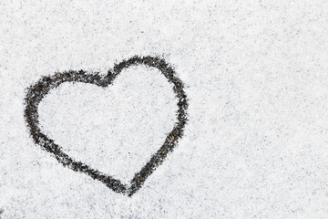 heart drawn in snow winter forest nature