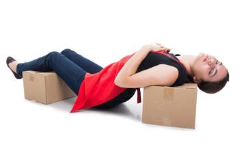 Woman clerk layed asleep on cardboard box