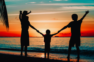 happy family with kids play on sunset beach