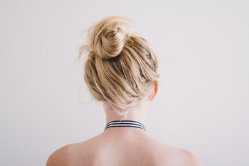 Girl with a messy topknot