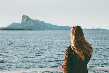 Woman tourist traveling by sea ferry in Norway landscape Travel Lifestyle concept adventure weekend vacations outdoor