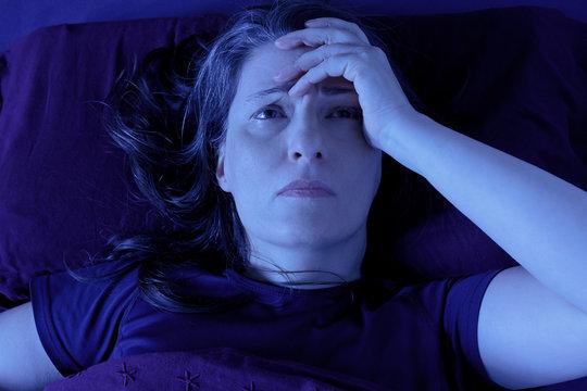 woman awake bed night insomnia