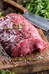 Beef Steak. Raw beef steak. Big Rib Eye steak on wooden board with herb salt and pepper