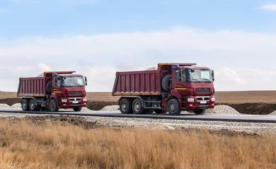 Dump trucks with gravel