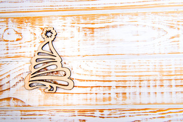 Wooden christmas tree on white wooden background. Winter time. Empty space for text.