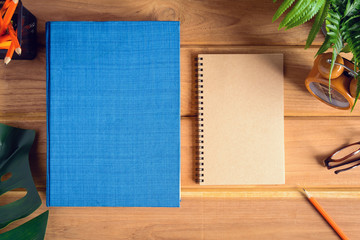 top view book and pencil note on wood table
