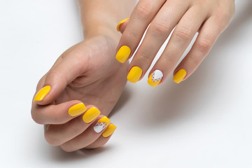 yellow nails with white triangles on square short nails
