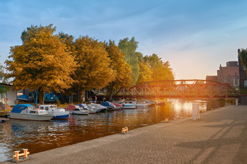 Motor boats by historical metal bridge in in Szczecin, Poland
