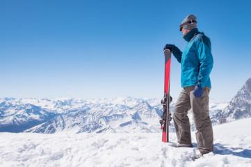 Man with ski on mountain top