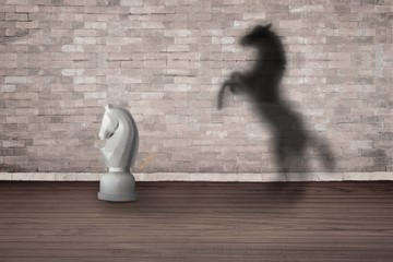 The concept of the hidden potencial. chess horse in the room which casts a shadow on the wall.