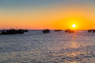 Vietnam village fishing boats ships sunset light
