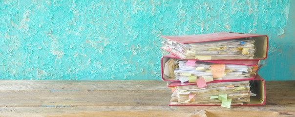 stack of messy file folders and documents,red tape concept,free copy space