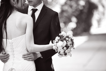 loving asian newly-wed couple, black and white
