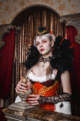 Beautiful vampire girl in vintage costume on Halloween day.