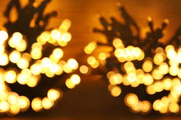 glitter garland lights background. gold and black. de-focused.