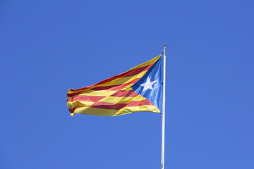 Catalan flag on the wind in blue sky
