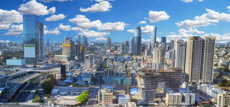 Colorful panoramic HDR image of the cloudy skyline of Tel Aviv with its skyscrapers - aerial image, Israel