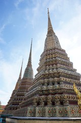 Stupa and statue at Wat Arun temple in Bangkok