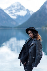 Beautiful Girl enjoys scenic mountain view at lake Plansee in Austria