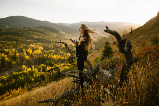 Mindfulness Woman With Long Hair Blowing in the Wind on a Mountain