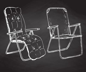 Two folding chairs hand drawn chalk on a chalkboard. Vector illustration in a sketch style