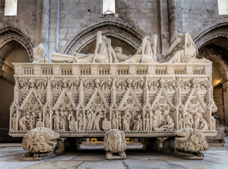 Medieval tomb of King Pedro I of Portugal, decorated with reliefs showing scenes from Saint Bartholomew's life, located in the 13th century Alcobaca Monastery