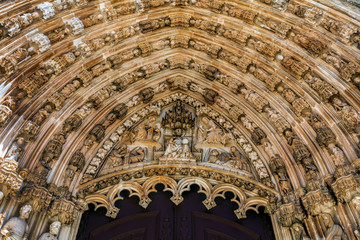 Tympanum above the main entrance to the Batalha Monastery in Batalha, Portugal, a prime example of the Portuguese Gothic architecture.