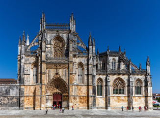 Details of the facade of the 14th century Batalha Monastery in Batalha, Portugal, a prime example of Portuguese Gothic architecture, UNESCO World Heritage site.