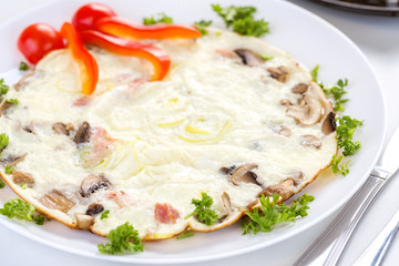 Tasty omelette with mushrooms