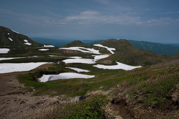 Panoramic view on green slopes around Mount Kurodake, Daisetsuzan National Park, Hokkaido, Japan