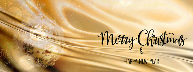 Christmas bauble on a gold and silver abstract backdrop with silk fabric. With quote 'Merry Christmas & Happy New Year'. Panoramic size, perfect for social media headers..
