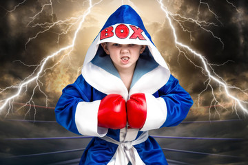 Little boy boxer with red gloves and robe.Little champion.The big wins.