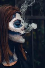 Woman in Skeleton costume celebrating Halloween