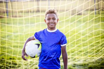 Diverse young boy on a youth soccer team