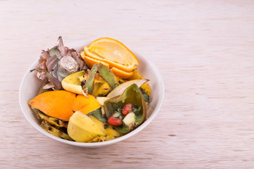 Bowl of household vegetable and fruits refuse collected for compost