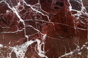 Dark red marble as a background, texture