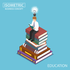 Isometric businessman reading at the top of book stack.