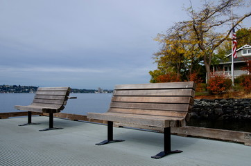 Benches on a pier near Washington lake surf line in Medina beach park