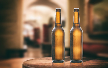 Beer bottles on a wooden table, abstract bar background. 3d illustration