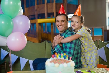 Happy father and daughter celebrating birthday party