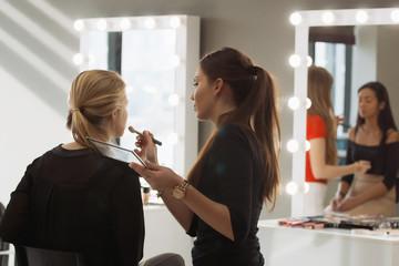 Make-up artist work in her studio