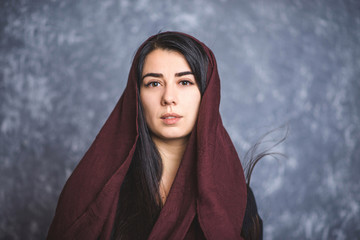 portrait of Arab women with long hair in a scarf