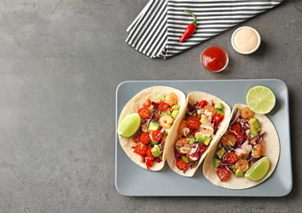 Plate with delicious shrimp tacos on kitchen table