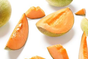 Sliced ripe melon on white background