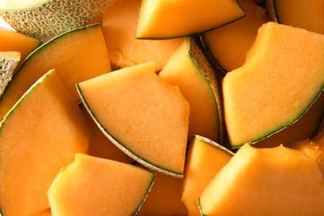 Fototapete - Sliced ripe melon as background
