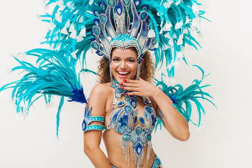 Poster Carnaval Beautiful cheerful samba dancer portrait wearing blue traditional costume