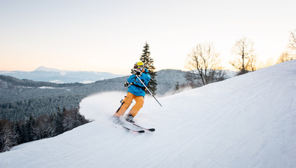 Skier man in snow powder produces braking on the slope of mountain on the winter resort