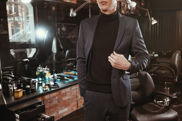 businessman in barbershop/ Fashionable stylish man model in a suit in barbershop