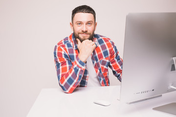 Handsome Man working on computer with isolated screen in office interior.